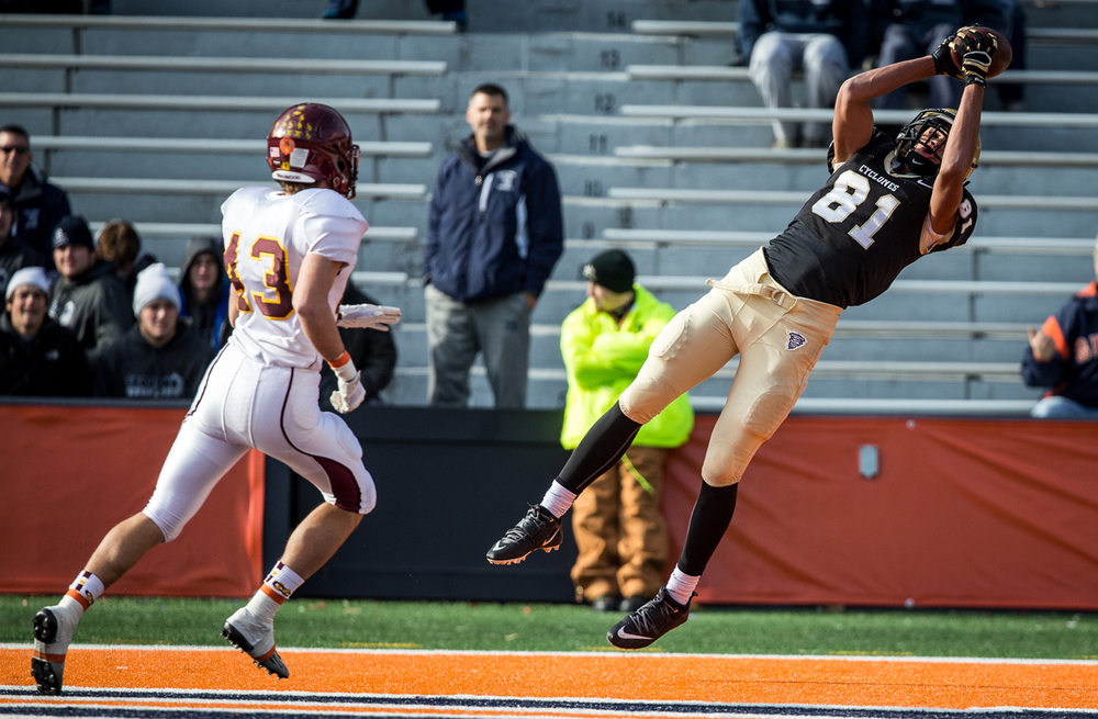 Sacred Heart-Griffin's Albert Okwuegbunam (81) makes a leaping catch for a 28-yard touchdown against Lombard Montini's Alex Floeckher (43) in the second half during the IHSA Class 5A state championship game at Memorial Stadium, Saturday, Nov. 29, 2014, in Champaign, Ill. Justin L. Fowler/The State Journal-Register