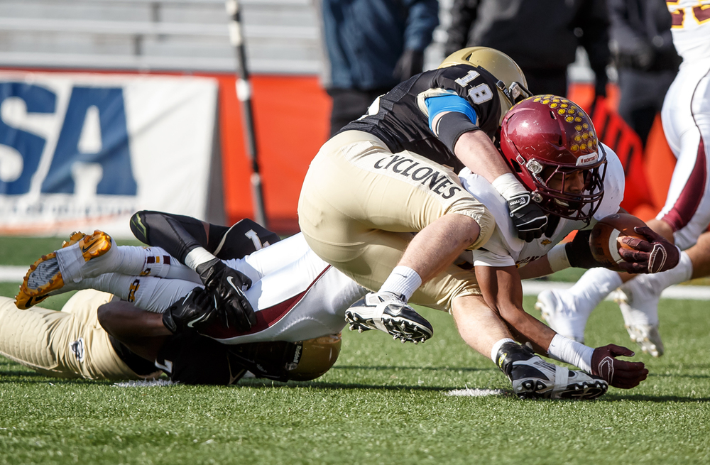 Sacred Heart-Griffin's Avery Andrews (7) and Cole Hillestad (18) combine to stop Lombard Montini's Prince Walker (28) short of the goal line in the first half during the IHSA Class 5A state championship game at Memorial Stadium, Saturday, Nov. 29, 2014, in Champaign, Ill. Justin L. Fowler/The State Journal-Register