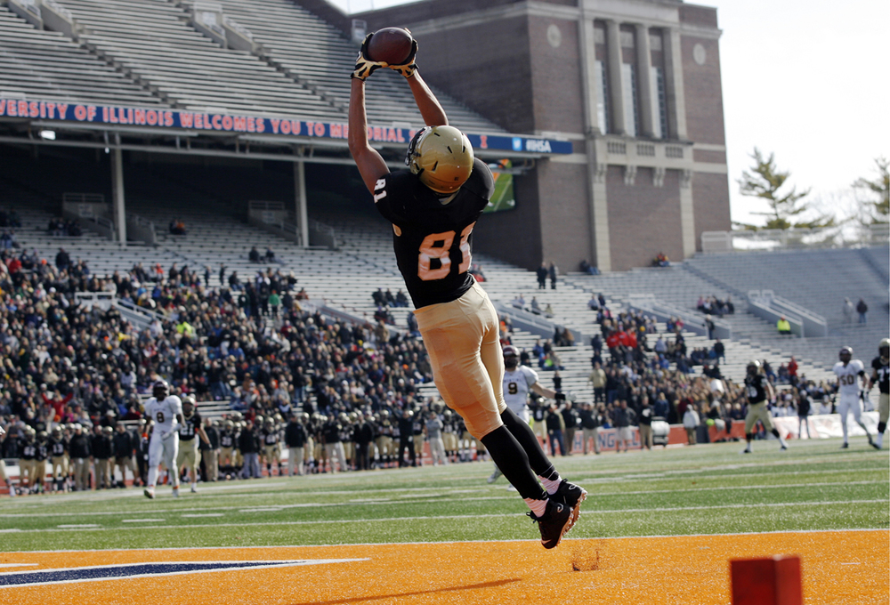 Sacred Heart-Griffin's Albert Okwuegbunam grabs a touchdown pass against Montini during the Class 5A football championship game at Memorial Stadium Saturday, Nov. 29, 2014. Ted Schurter/The State Journal-Register