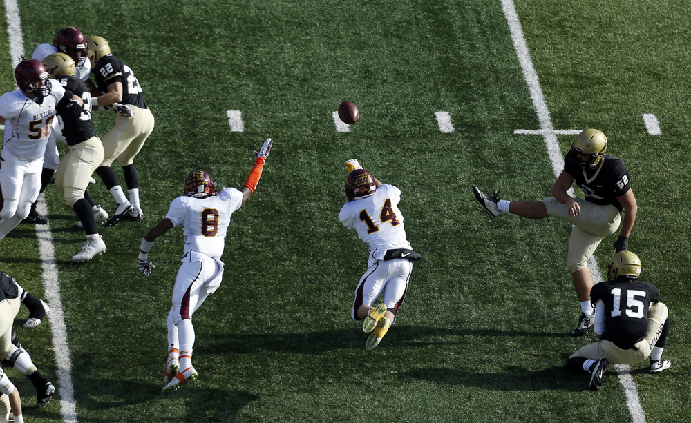 Montini's Mitch West blocks Sacred Heart-Griffins extra point attempt in the first half during the Class 5A football championship game at Memorial Stadium Saturday, Nov. 29, 2014. Ted Schurter/The State Journal-Register