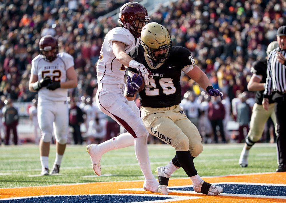 Sacred Heart-Griffin's Sam Sergent (28) goes in for a touchdown as Lombard Montini's Michael Reilley (21) tries to stip the ball away in the second half during the IHSA Class 5A state championship game at Memorial Stadium, Saturday, Nov. 29, 2014, in Champaign, Ill. Justin L. Fowler/The State Journal-Register