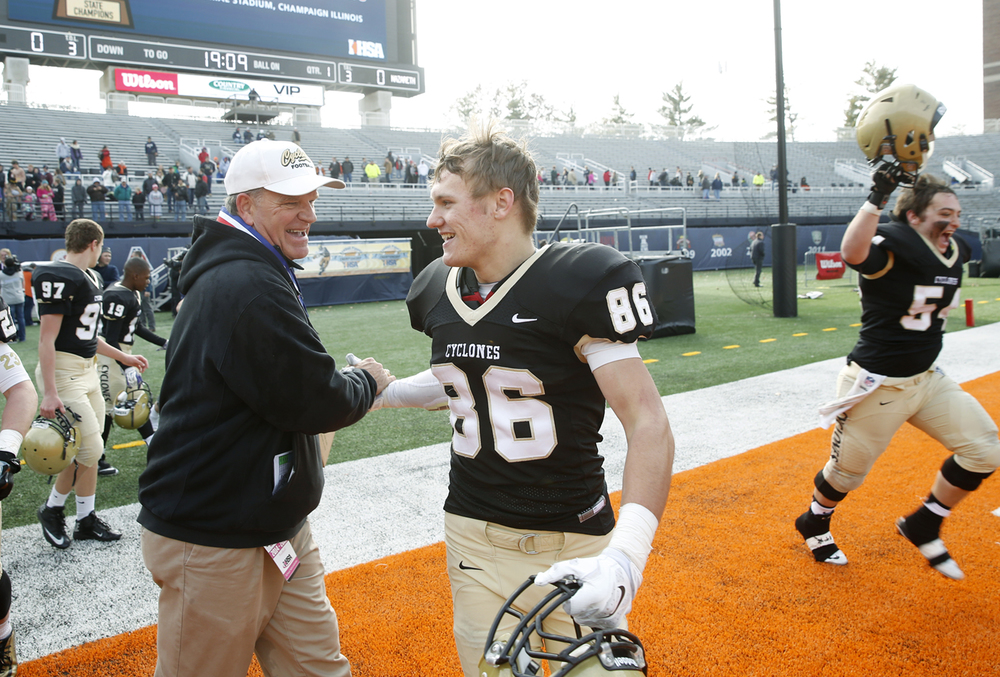 Sacred Heart-Griffin head coach Ken Leonard congratulates Sean Mason after the Cyclones defeated Montini during the Class 5A football championship game at Memorial Stadium Saturday, Nov. 29, 2014. Ted Schurter/The State Journal-Register
