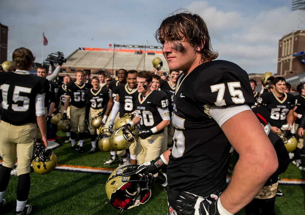 Sacred Heart-Griffin's Michael Zeigler (75) holds in the tears as the Cyclones celebrate after defeating Lombard Montini 29-14 in the IHSA Class 5A state championship game at Memorial Stadium, Saturday, Nov. 29, 2014, in Champaign, Ill. Justin L. Fowler/The State Journal-Register
