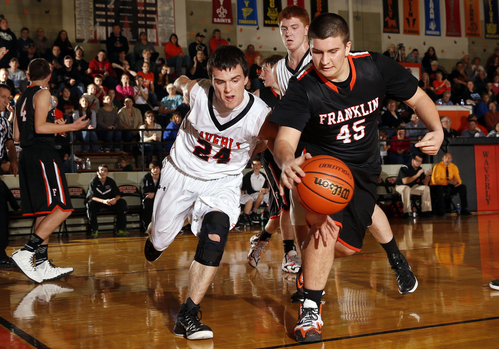 Waverly's Nathan Thresher and Franklin's Lewis Wallbaum race for a loose ball.