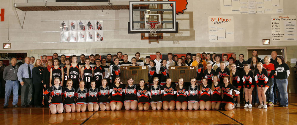The teams, faculty, administrators and cheerleaders from Franklin and Waverly High Schools pose together after getting plaques that commemorate their more than 90-year-old rivalry that is coming to an end after this season during a ceremony before the varsity game Friday, Dec. 5, 2014 at Waverly High School.