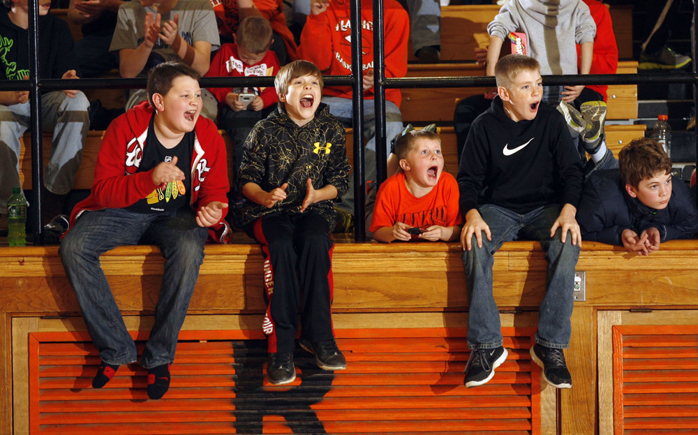 Franklin fans cheer for their team as they take on Waverly Friday, Dec. 5, 2014 at Waverly High School. Ted Schurter/The State Journal-Register