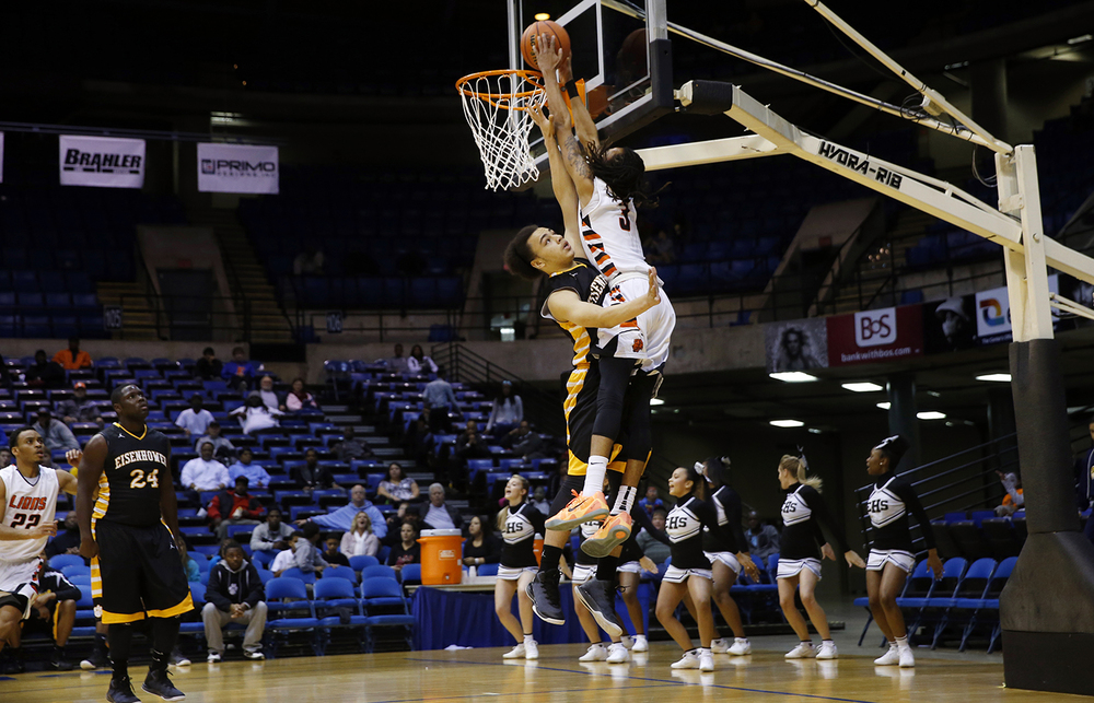Lanphier's Aarin Thames dunks the ball over Decatur Eisenhower's Tamon Davis during the Capital City Showcase Saturday at the Prairie Capital Convention Center Saturday, Dec. 6, 2014. Ted Schurter/The State Journal-Register