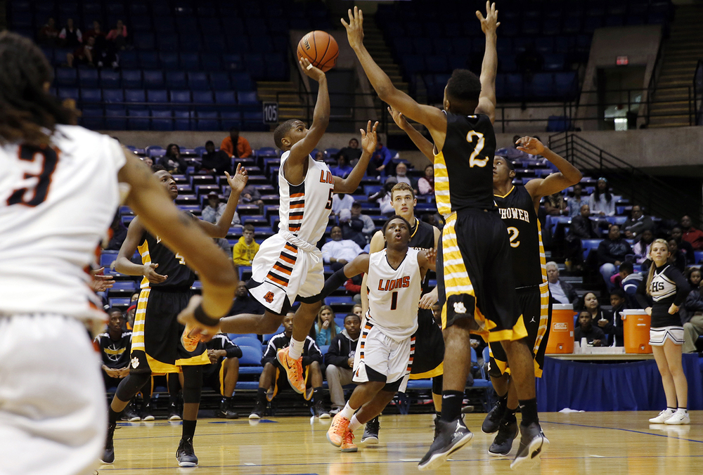 Lanphier's Xavier Bishop shoots in the lane against Decatur Eisenhower during the Capital City Showcase Saturday at the Prairie Capital Convention Center Saturday, Dec. 6, 2014. Ted Schurter/The State Journal-Register