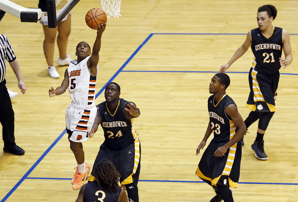 Lanphier's Xavier Bishop slips past the Decatur Eisenhower defense on his way to the hoop during the Capital City Showcase Saturday at the Prairie Capital Convention Center Saturday, Dec. 6, 2014. Ted Schurter/The State Journal-Register