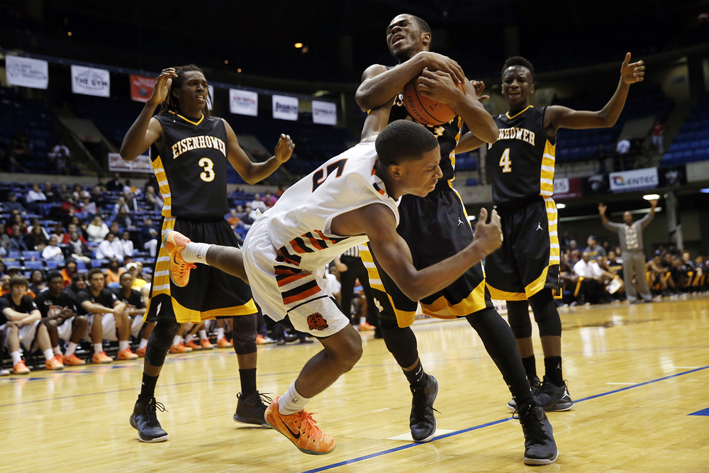 Decatur Eisenhower's Keith Byars wrests the ball away from Lanphier's Xavier Bishop during the Capital City Showcase Saturday at the Prairie Capital Convention Center Saturday, Dec. 6, 2014. Ted Schurter/The State Journal-Register
