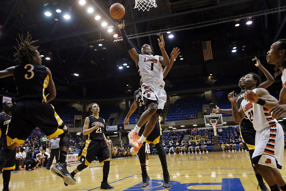 Lanphier's Yakeema Rose drops in two against Decatur Eisenhower during the Capital City Showcase Saturday at the Prairie Capital Convention Center Saturday, Dec. 6, 2014. Ted Schurter/The State Journal-Register