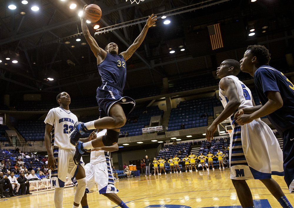 Southeast's Sabree Bakari soars in for a dunk against Decatur MacArthur during the Capital City Showcase Saturday at the Prairie Capital Convention Center Saturday, Dec. 6, 2014. Ted Schurter/The State Journal-RegisterS