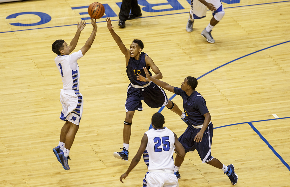 Decatur MacArthur's Dallas McClain launches a three under pressure from Southeast's Isaiah Walton during the Capital City Showcase Saturday at the Prairie Capital Convention Center Saturday, Dec. 6, 2014. Ted Schurter/The State Journal-Register