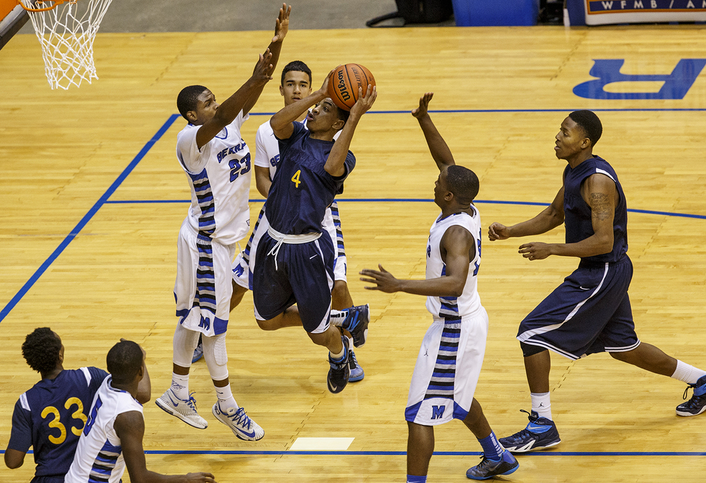 Decatur MacArthur's Keymonta Johnson defends the hoop as Southeast's Trevyon Williams drives the lane during the Capital City Showcase Saturday at the Prairie Capital Convention Center Saturday, Dec. 6, 2014. Ted Schurter/The State Journal-Register