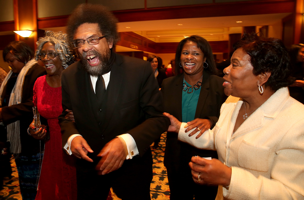 Cornel West, keynote speaker for the Springfield Urban League's 88th annual awards dinner, is escorted into the main ballroom of the Crowne Plaza hotel in Springfield on Friday evening, Dec. 5, 2014 by Urban League Chief Operations Officer Lillie Jasper, left, and President and CEO Nina Harris. At right is Beverly Peters. David Spencer/The State Journal-Register