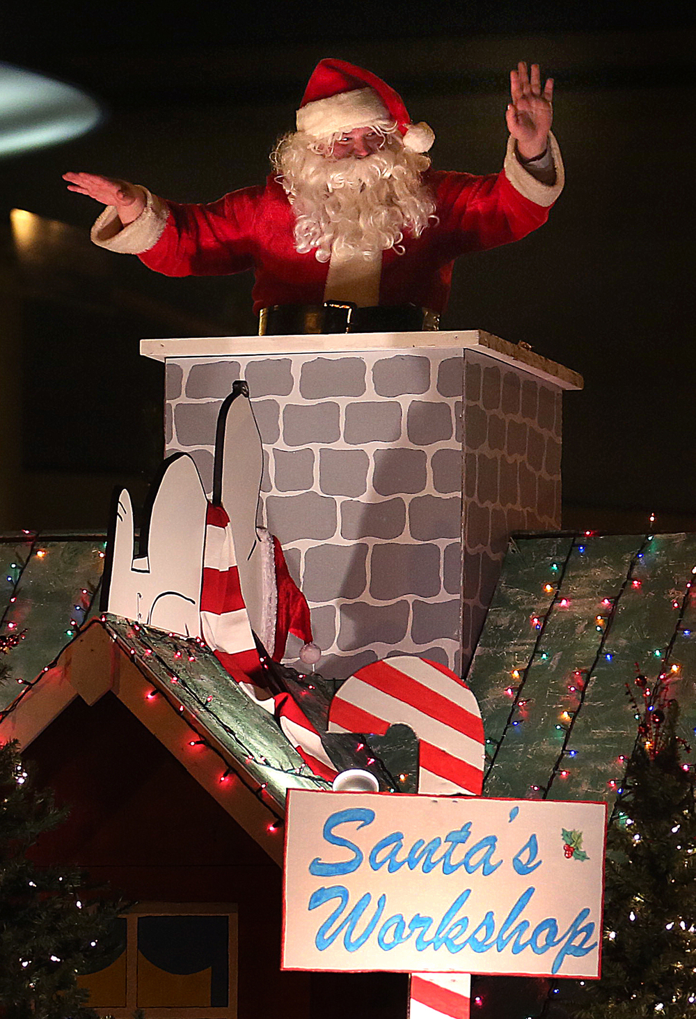 "Emerging from a chimney while waving to those lining the parade route was Santa Claus, taking up the rear of the parade Saturday evening. ""Christmas Comedy"" was the theme of the 43rd Annual Springfield Jaycees Christmas Parade held in downtown Springfield on Saturday evening, Dec. 6, 2014. David Spencer/The State Journal-Register"