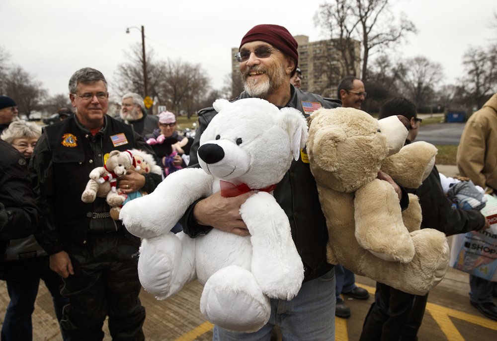 Byron Shryock carries two large stuffed bears into Conctact Ministries during the Sid Wood Memorial Toy Run Sunday, Nov. 30, 2014. More than five dozen motorcycles and 80 participants delivered donations of toys, food and cash to the transitional shelter. Ted Schurter/The State Journal-Register