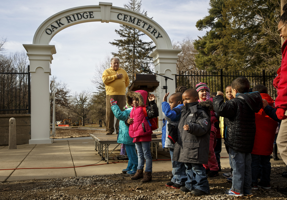 Head Start students from the Urban League of Springfield lead guests, including Master of Ceremonies Sam Madonia on stage, in the Pledge of Allegiance during the dedication of the original entrance to Oak Ridge Cemetery Wednesday, Dec. 3, 2014. Ted Schurter/The State Journal-Register