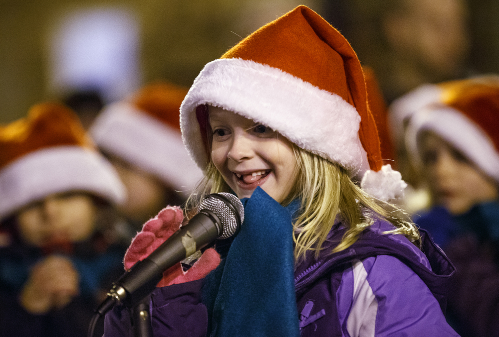 "Bella Hose sings ""All I want for Christmas Is My Two Front Teeth"" without at least two front teeth during the opening ceremonies for the Old Capitol Holiday Walk on the Old State Capitol Plaza Wednesday, Dec. 3, 2014. Ted Schurter/The State Journal-Register"