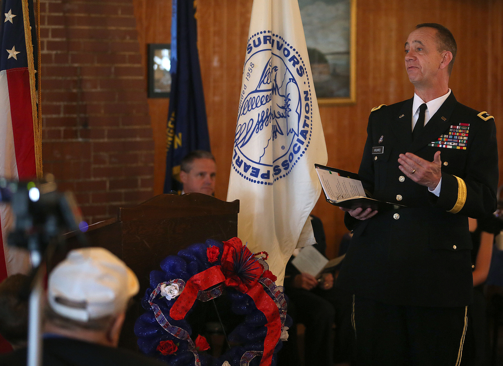 Illinois National Guard Adjutant General Daniel Krumrei delivers the keynote address during the ceremony Sunday morning. A dual ceremony honoring the 73rd anniversary of the attack on American naval forces at Pearl Harbor and the 10th anniversary of the dedication of the World War II memorial in Springfield took place at the Disabled American Veterans Hall at Lake Springfield on Sunday, Dec. 7, 2014. David Spencer/The State Journal-Register