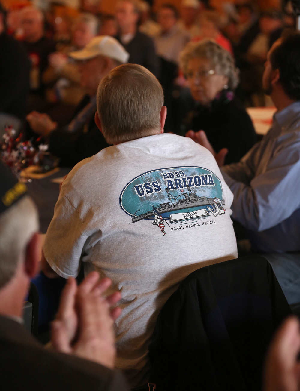 Rob Rister of Dawson wore a Pearl Harbor USS Arizona tee-shirt to the ceremony Sunday. Rister said his father, who spent his career in the Navy, survived the surprise attack at Pearl Harbor while aboard the USS Vestal. A dual ceremony honoring the 73rd anniversary of the attack on American naval forces at Pearl Harbor and the 10th anniversary of the dedication of the World War II memorial in Springfield took place at the Disabled American Veterans Hall at Lake Springfield on Sunday, Dec. 7, 2014. David Spencer/The State Journal-Register