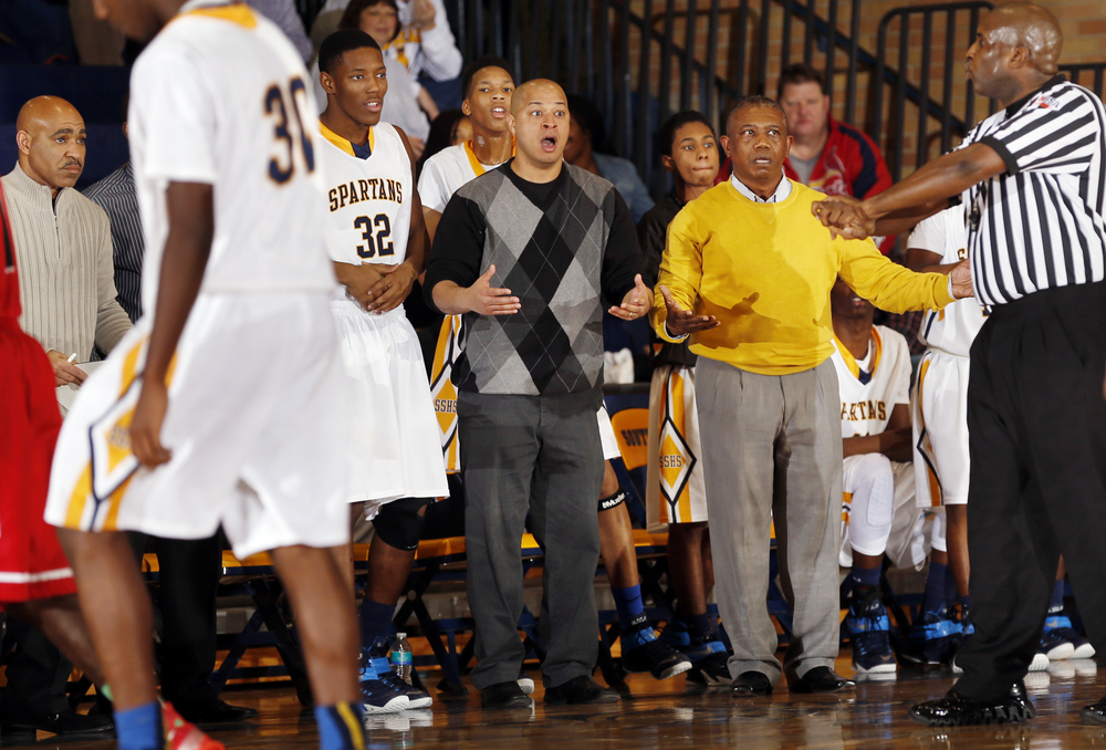 Southeast's head coach Lawrence Thomas questions a foul call against the  Spartans as they face Springfield at Southeast High School Tuesday Dec. 9, 2014. Ted Schurter/The State Journal-Register