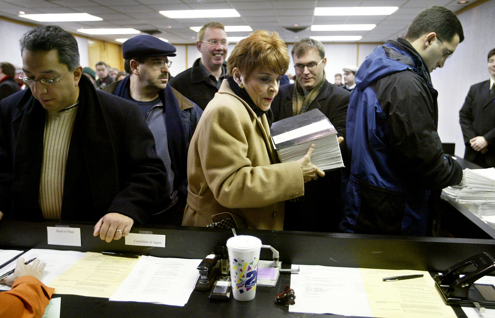 Illinois State Treasurer Judy Baar Topinka presents her 1,068-page election petition to a election specialist as part of her filing to run for  the governor of Illinois at State Board of Elections Dec. 13, 2005. File/The State Journal-Register
