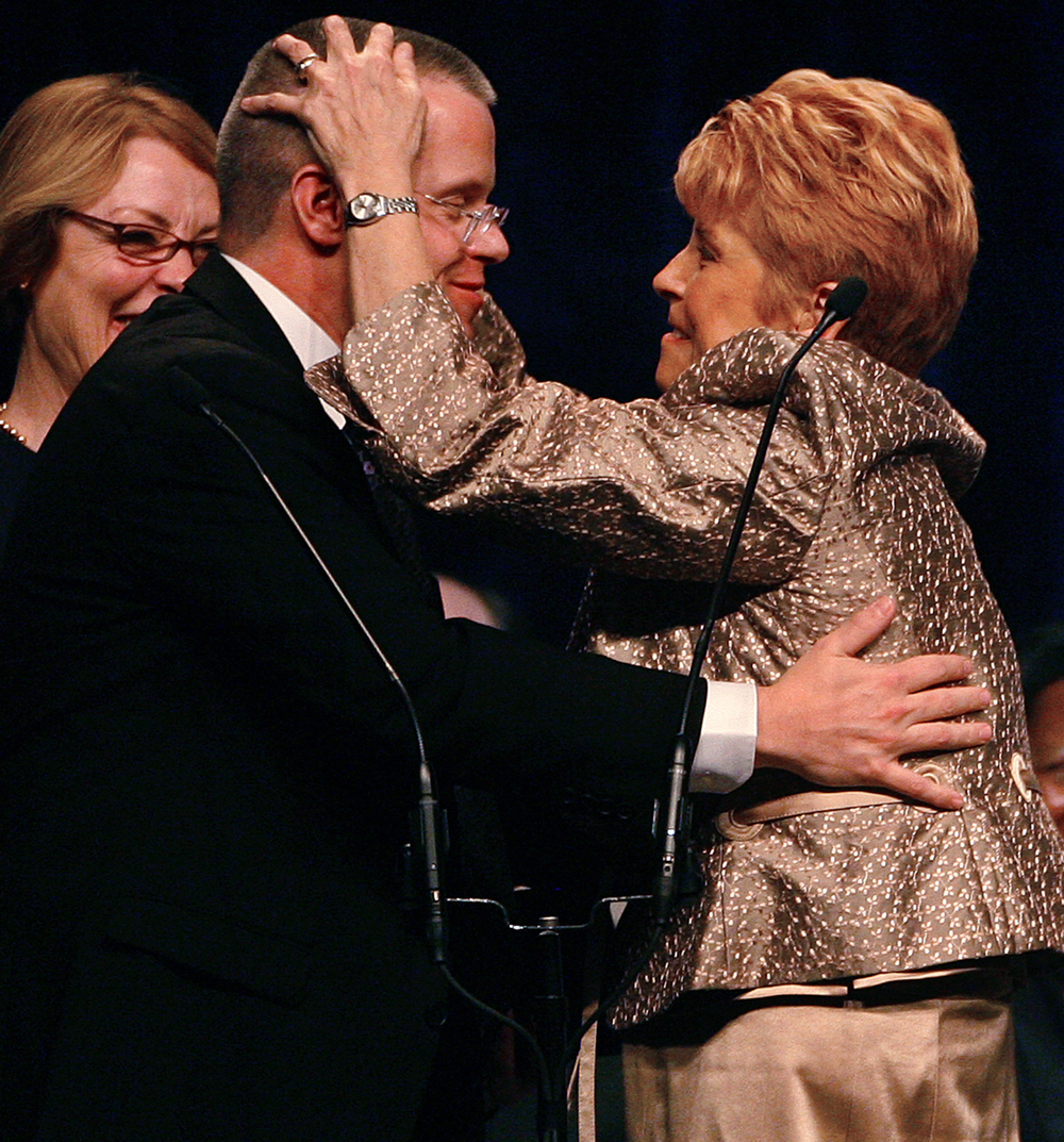 Illinois Comptroller Judy Baar Topinka embraces her son Joseph Baar Topinka moments after he presented the oath of office for his mother at the Inauguration Jan. 10, 2011. File/The State Journal-Register