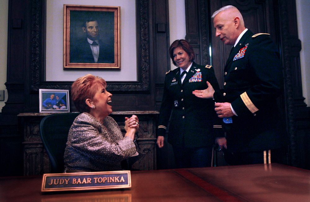 Illinois State Comptroller Judy Baar Topinka hosts a reception in her statehouse office Monday, Jan. 10, 2011 after the inauguration. Meeting Topinka are Illinois Army National Guard Brigadier General Steven Huber, right, and Illinois National Guard Colonel, Chief, ILNG Joint Staff's Alicia Tate-Nadeau. File/The State Journal-Register