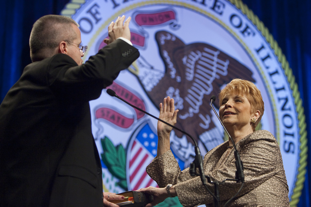 Illinois Comptroller Judy Baar Topinka takes the oath of office administered by her son, Special Officer Joseph Baar Topinka, during the Inaugural Ceremony at the Prairie Capital Convention Center in Springfield, Ill., Monday, Jan. 10, 2011. File/The State Journal-Register