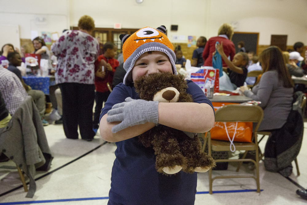 Xavier Porter proudly displays his new Monsters hat, a pair of gloves and a teddy bear Wednesday, Dec. 10, 2014 at Harvard Park school. The items were gifts from Corrections employee Anne Rayhill. Rich Saal/The State Journal-Register