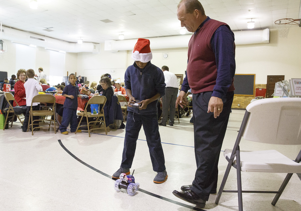 Jamon Williams, a second-grader, learns to drive a radio-controlled car with Mike Funk Wednesday, Dec. 10, 2014 at Harvard Park school. Rich Saal/The State Journal-Register