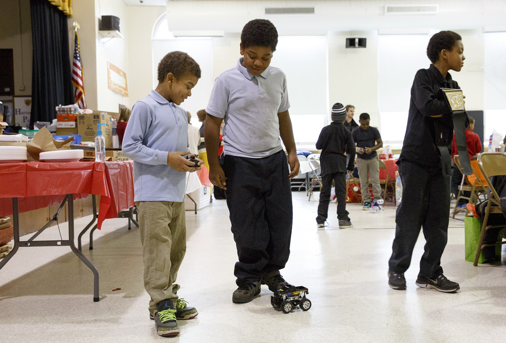 Sanquinton and D'Angelo Standley play with a new radio-controlled car Wednesday, Dec. 10, 2014 at Harvard Park school. Rich Saal/The State Journal-Register