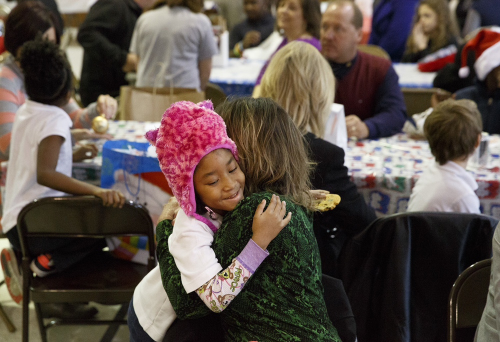 Kountess Masters-Stout thanks her lunch buddy Michelle Buscher with a hug after their lunch at Harvard Park school Wednesday, Dec. 10, 2014. Rich Saal/The State Journal-Register