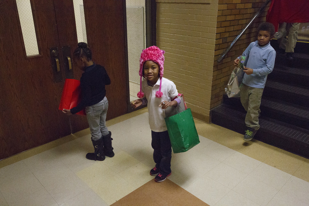 Kountess Masters-Stout wears her new hat on her way back to her classroom Wednesday, Dec. 10, 2014 at Harvard Park school. Rich Saal/The State Journal-Register