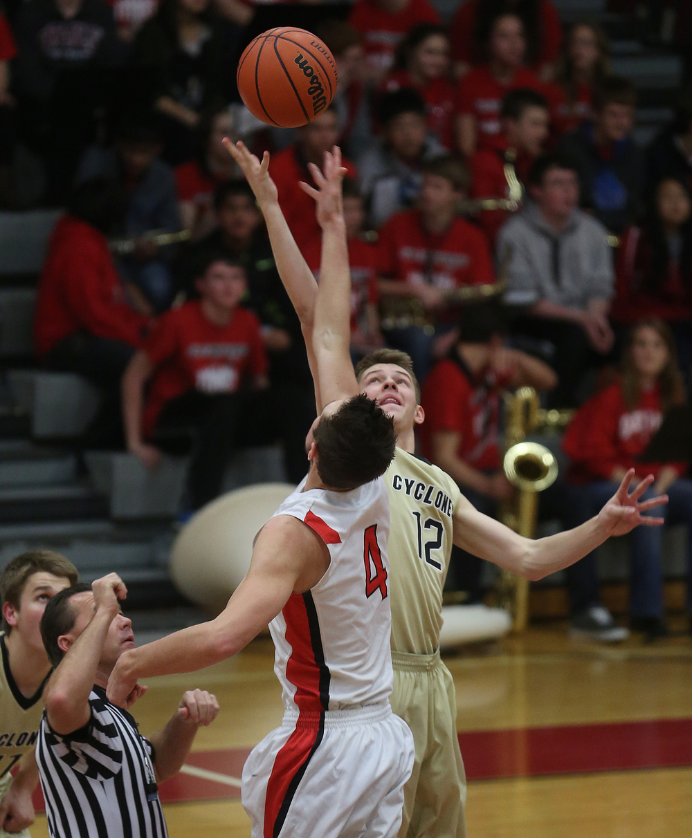 Tipping off at the start of the game was Cyclones player Sean McDonald and Glenwood's Sam Anderson. Chatham Glenwood defeated Sacred Heart Griffin 54-40 in boys basketball action at Glenwood High School on Friday evening, Dec. 12, 2014. David Spencer/The State Journal-Register