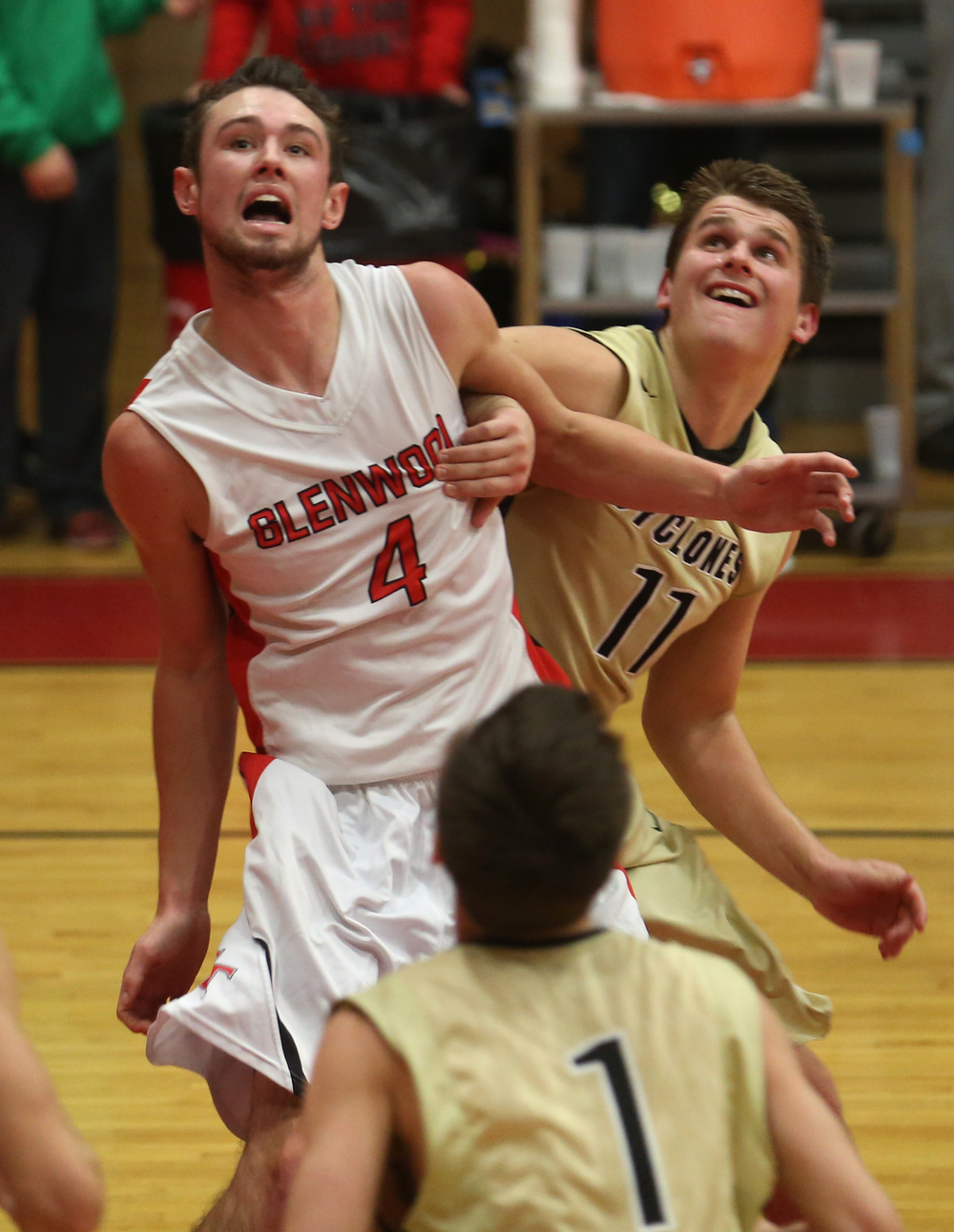 Cyclones player Max Bloink and Glenwood's Sam Anderson exchange elbows while looking for a rebound. Chatham Glenwood defeated Sacred Heart Griffin 54-40 in boys basketball action at Glenwood High School on Friday evening, Dec. 12, 2014.David Spencer/The State Journal-Register