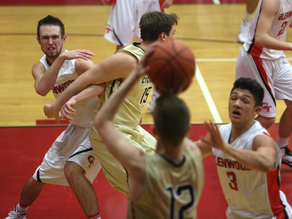 Glenwood's Sam Anderson scuffles with Cyclones player Michael Zeigler while Cyclone's player Sean McDonald prepares to put up a shot. At right front defending is Glenwood's Drew Parriott. Chatham Glenwood defeated Sacred Heart Griffin 54-40 in boys basketball action at Glenwood High School on Friday evening, Dec. 12, 2014. David Spencer/The State Journal-Register