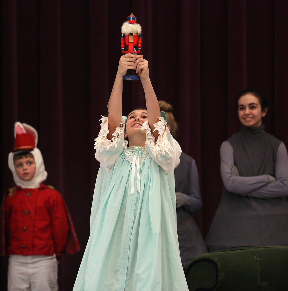 SBC dancer Olivia Pennell in the role of Clara holds up the Nutcracker right before the Nutcracker prince shows up.