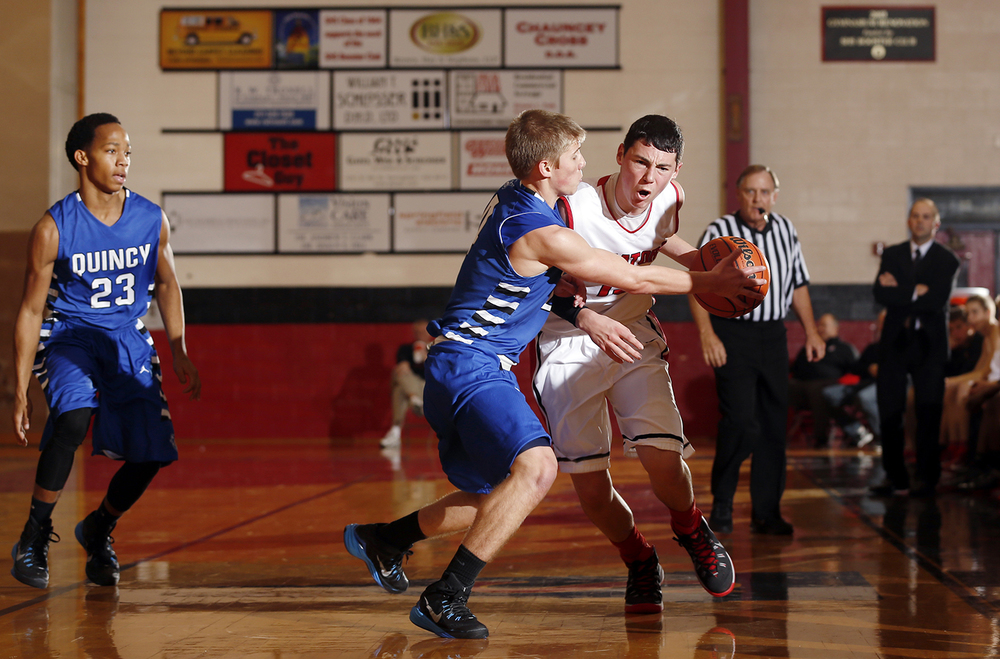Springfield's Trevor Minder is fouled by a Quincy defender as he brings the ball upcourt at Springfield High School Saturday, Dec. 13, 2014. Ted Schurter/The State Journal-Register