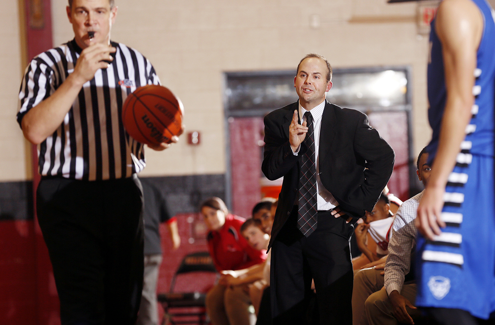 Springfield head coach Matt Reed disputes a possesion call in favor of Quincy at Springfield High School Saturday, Dec. 13, 2014. Ted Schurter/The State Journal-Register
