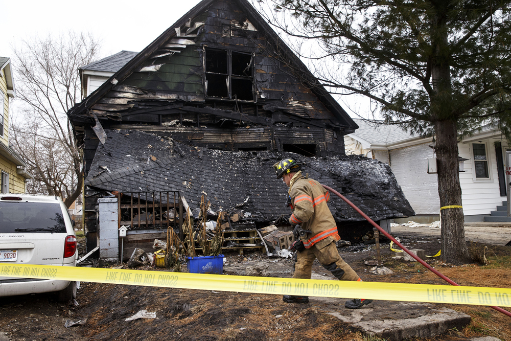 Several occupants were hurt after a fire destroyed a home at 2119 S. 10th St. Tuesday morning. Rescue officials arrived shortly after 7 a.m. to find the home fully engulfed. Ted Schurter/The State Journal-Register