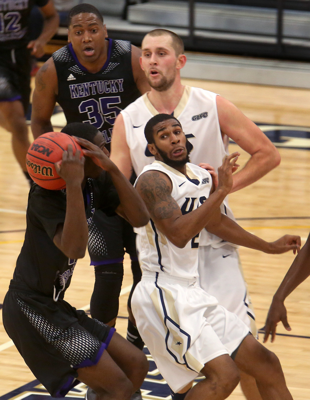 Panthers player Basil Deveaux tries to keep control of the ball while under pressure from Stars player Davi Austin at center. The Kentucky Wesleyan Panthers defeated the UIS Prairie Stars 80-61 in men's basketball action at the TRAC center on the UIS campus on Sunday, Dec. 14, 2014. David Spencer/The State Journal-Register