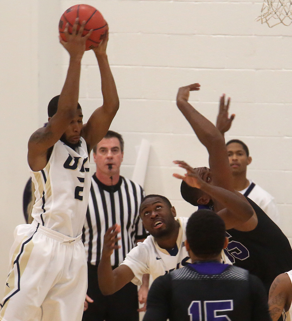 Stars player Davi Austin grabs a rebound. The Kentucky Wesleyan Panthers defeated the UIS Prairie Stars 80-61 in men's basketball action at the TRAC center on the UIS campus on Sunday, Dec. 14, 2014. David Spencer/The State Journal-Register