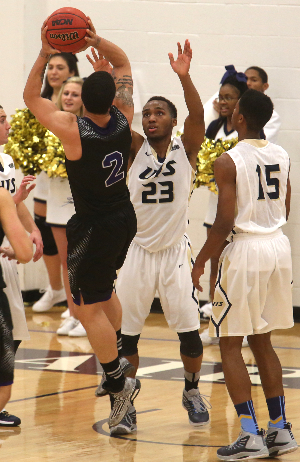 Stars player Mark Weems Jr. at center defends while Panthers player Tre Boutilier prepares to make a shot. The Kentucky Wesleyan Panthers defeated the UIS Prairie Stars 80-61 in men's basketball action at the TRAC center on the UIS campus on Sunday, Dec. 14, 2014. David Spencer/The State Journal-Register