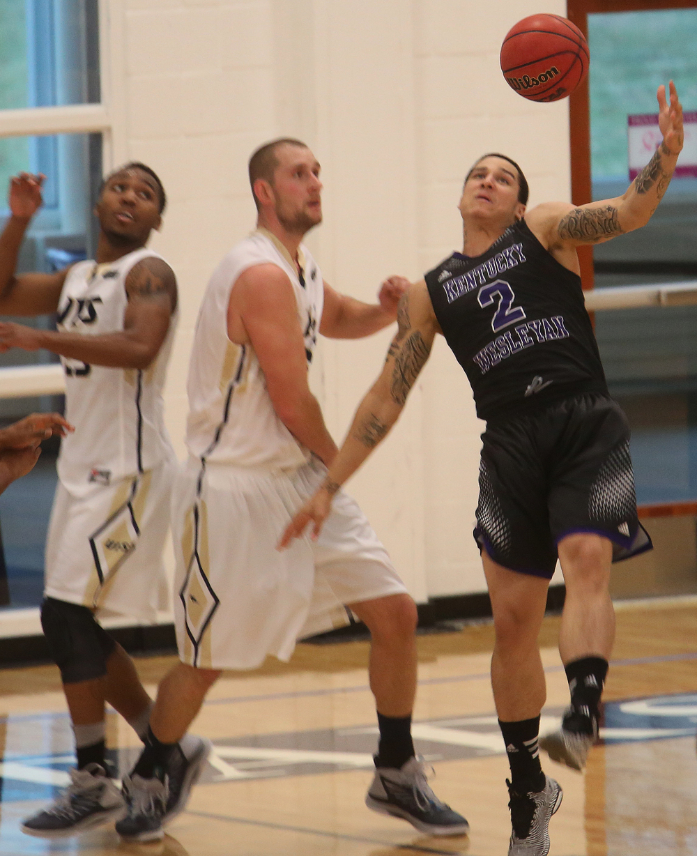 Panthers player Tre Boutilier tries to grab a rebound under pressure from Stars player Dylan Sparkman. The Kentucky Wesleyan Panthers defeated the UIS Prairie Stars 80-61 in men's basketball action at the TRAC center on the UIS campus on Sunday, Dec. 14, 2014. David Spencer/The State Journal-Register