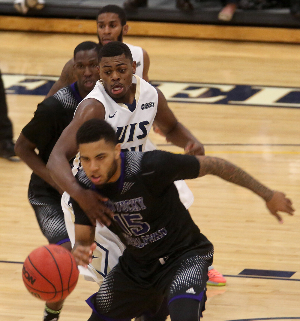 Stars player Jamall Millison gets his hand in front of Panthers player C.J. Blackwell during first half action. The Kentucky Wesleyan Panthers defeated the UIS Prairie Stars 80-61 in men's basketball action at the TRAC center on the UIS campus on Sunday, Dec. 14, 2014. David Spencer/The State Journal-Register