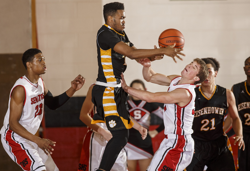 Decatur Eisenhower's Caleb Taylor fights for a loose ball between Springfield's Obediah Church, left, and Mason Fitch at Springfield High School Thursday, Dec. 18, 2014. Ted Schurter/The State Journal-Register