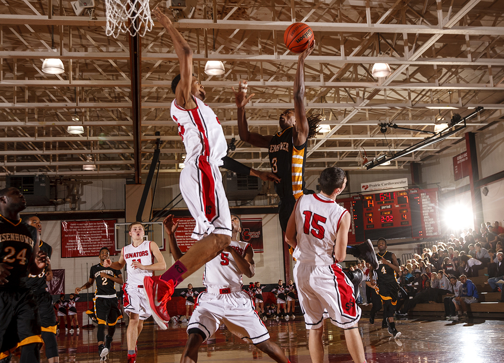 Springfield's Obediah Church winds up to sway away a shot by Decatur Eisenhower's Stephon Jarrett at Springfield High School Thursday, Dec. 18, 2014. Ted Schurter/The State Journal-Register