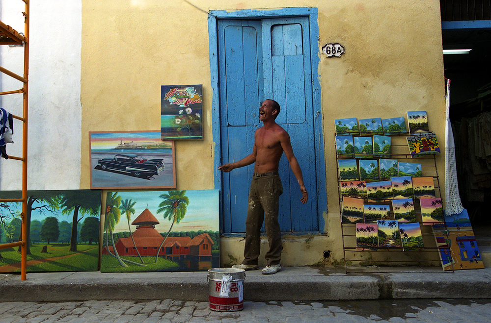 A street artist displays his artwork outside his home in Old Havana, Cuba, October 1999. File/The State Journal-Register/T.J. Salsman